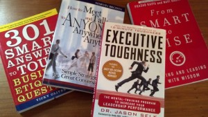 Four business related books by publicist Cathy Lewis.